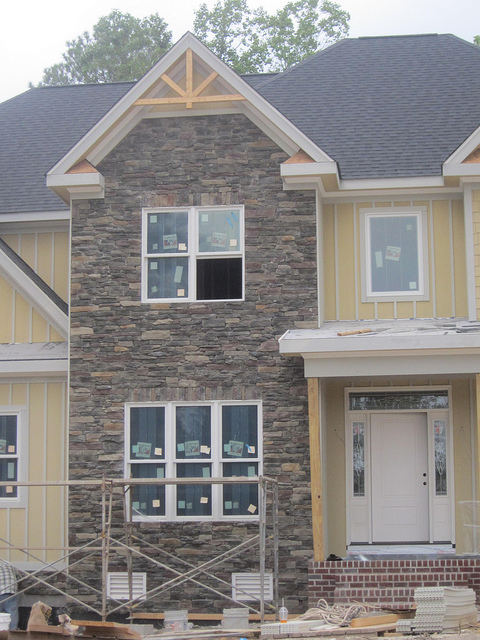 Using natural stone thin veneer texas on the exterior of your home stone cutters journal - Houses natural stone facades ...